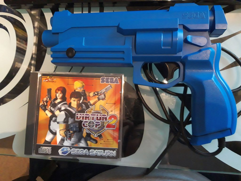 A blue light gun for the Sega Saturn, with a copy of Virtua Cop 2.